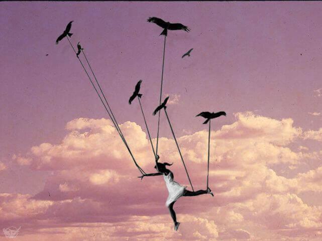 Bambina vola sorretta da uccelli