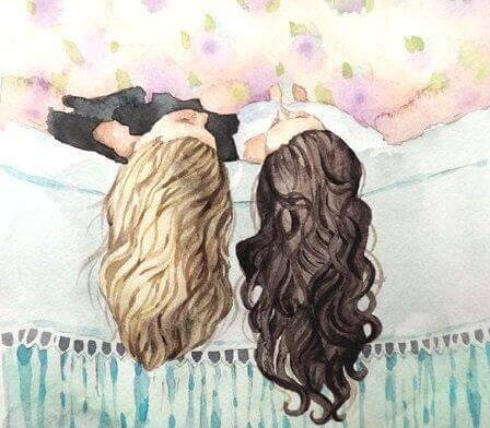 disegno due ragazze sdraiate sul letto
