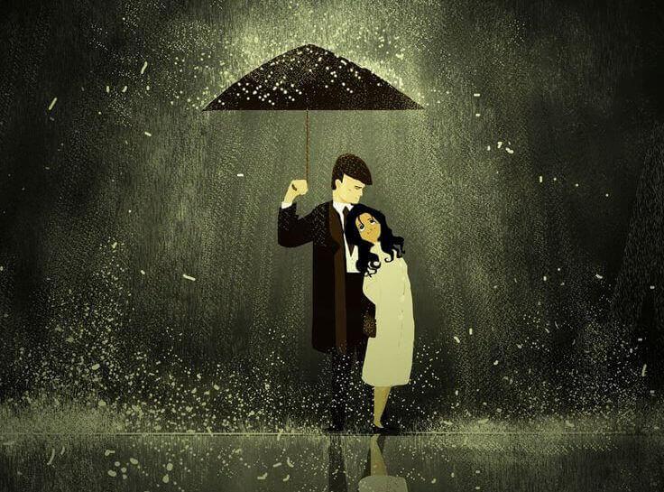 coppia che si protegge sotto l'ombrello