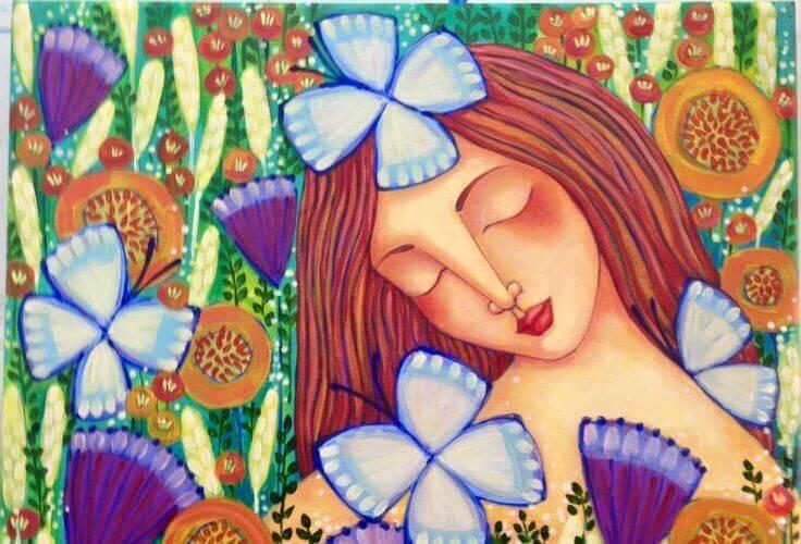 donna circondata da fiori e farfalle