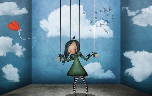 persona marionetta e palloncino a forma di cuore che vola via
