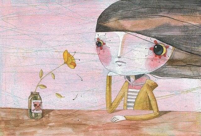 ragazza e fiore sul tavolino