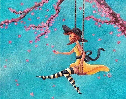 ragazza su altalena tra fiori di ciliegi
