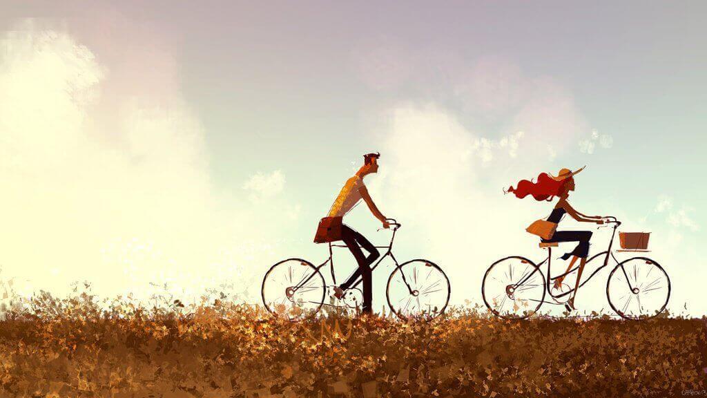 Coppia che passeggia in bicicletta