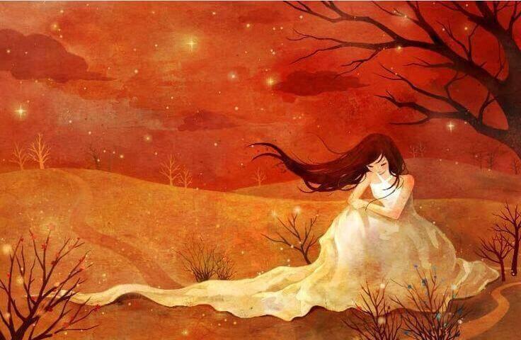 Donna triste e sola seduta vicino a un albero