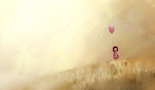 bambina con palloncino rosa
