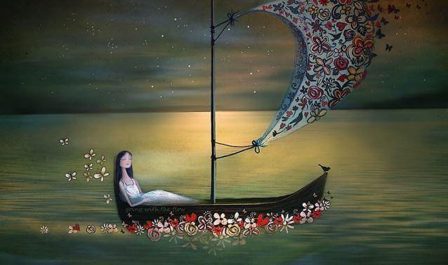 donna su una barca di fiori