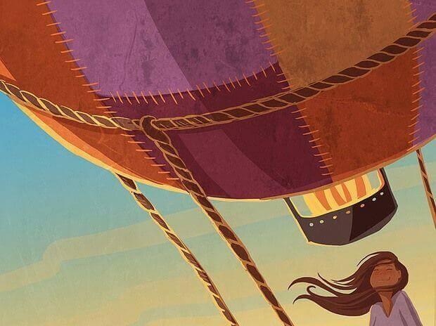 ragazza che viaggia in mongolfiera
