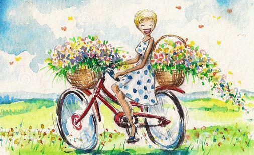 ragazza in bici con i fiori