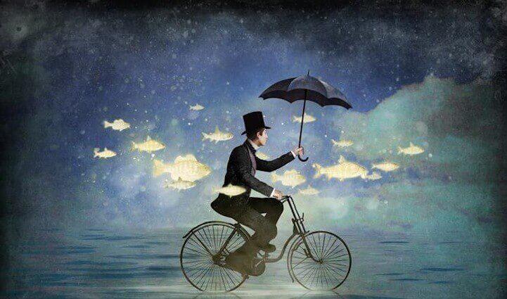 uomo in bici circondato da pesci volanti