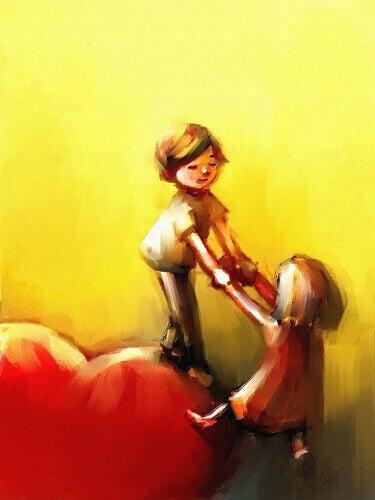 bambino afferra le mani di una bambina e la tira sù