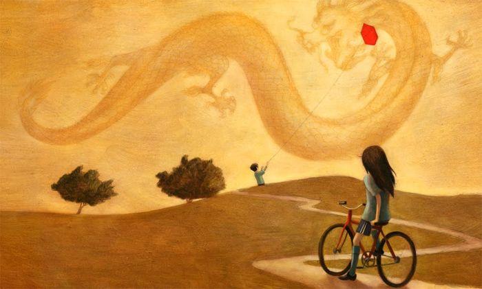 bambina in bicicletta guarda bambino con aquilone