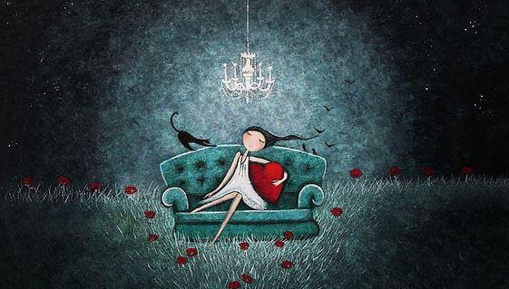 bambina sul divano e gatto nero