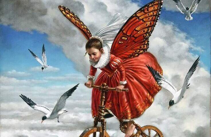 bambina vola sulla bicicletta con i gabbiani