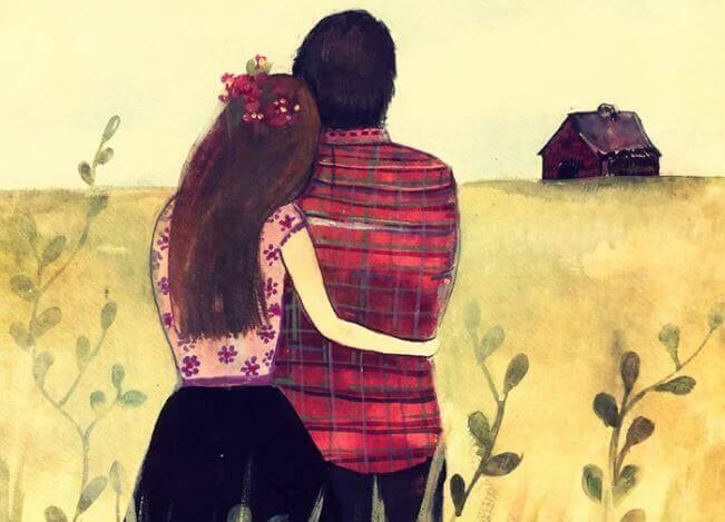 coppia-abbracciata-guardando-orizzonte