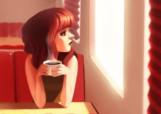 donna al bar che guarda fuori dalla finestra