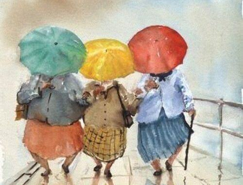 donne amiche con ombrelli colorati