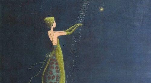 ragazza vestita di verde tocca pioggia di stelle