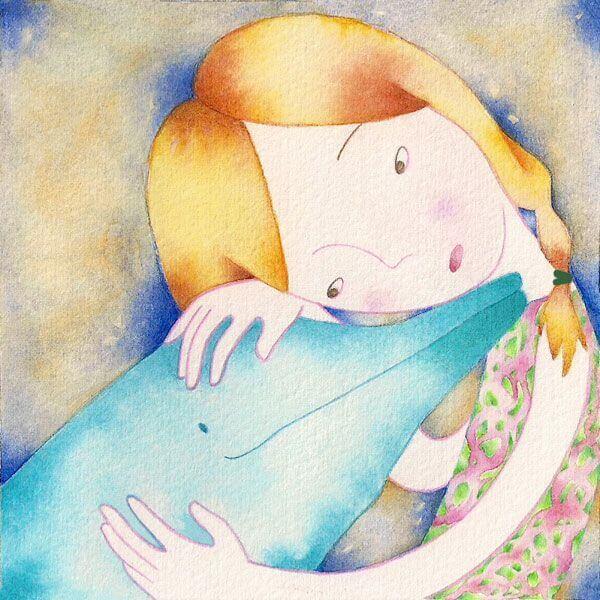 bambina che abbraccia un delfino