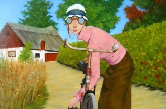 donna ciclista in campagna