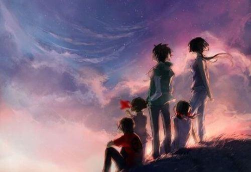 famiglia guarda l'alba