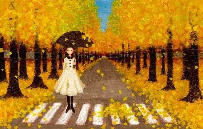 ragazza tra foglie gialle