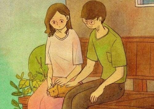 coppia seduta accarezza gatto