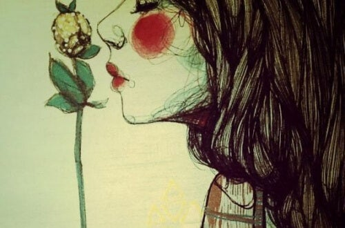donna che bacia fiore