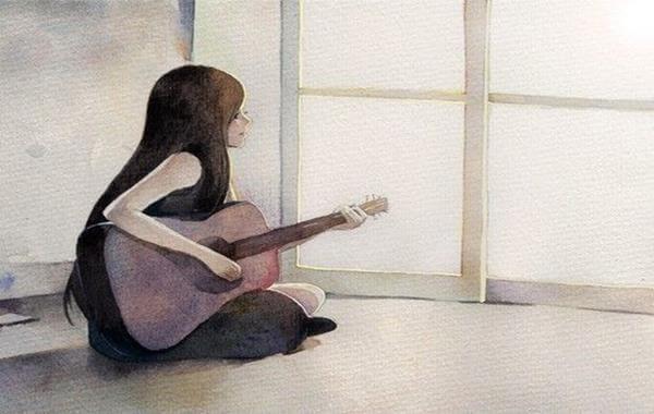 donna-suonando-chitarra