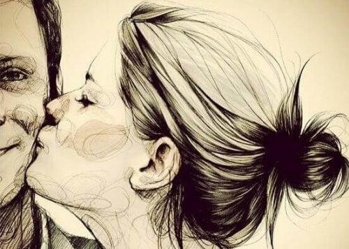 ragazza bacia sulla guancia ragazzo