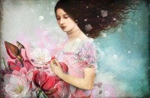 Donna che raccoglie fiori rosa