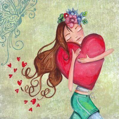 bambina felice che abbraccia un cuore