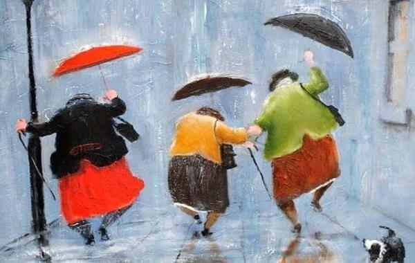 donne con ombrelli saltano sotto la pioggia