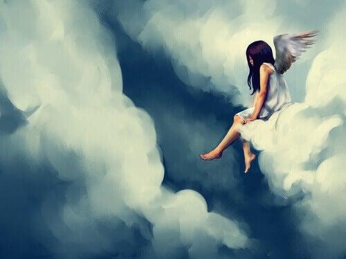 angelo seduto sulle nuvole