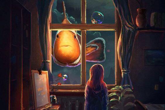 bambina che vede fuori dalla finestra un pesce pagliaccio