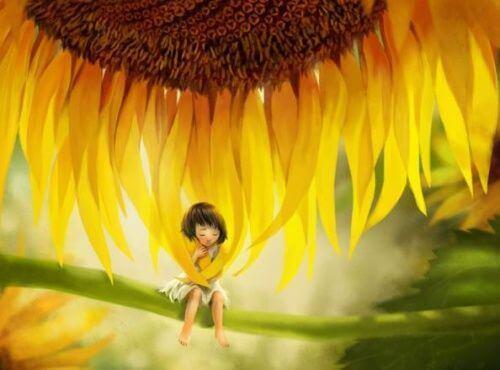 bambino avvolto da petali di girasole
