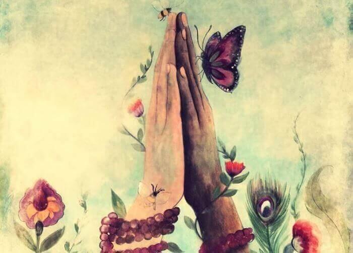 mani unite con farfalla