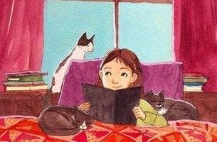 Bambina-che-legge-circondata-da-gatti