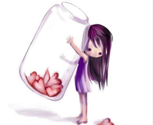 Bambina con barattolo pieno di cuori