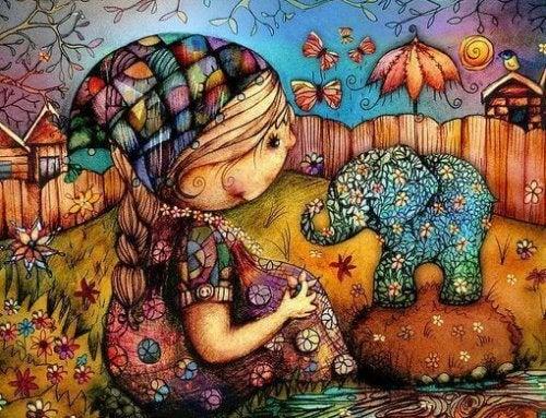 bambina ed elefante colorati