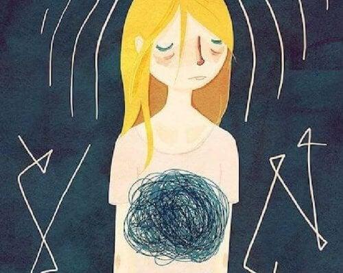 donna triste con morsa allo stomaco