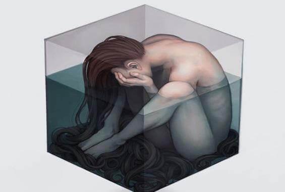donna triste in un cubo