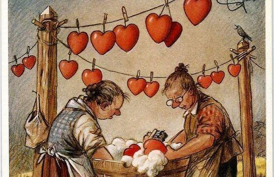 donne lavano e stendono cuori