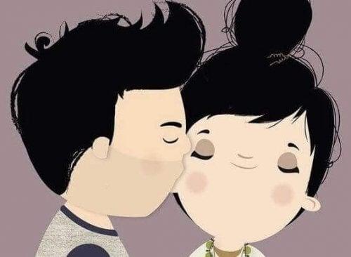 uomo che bacia sulla guancia una donna