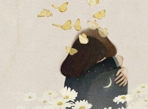 giovani-si-abbracciano-con-farfalle-sulla-testa