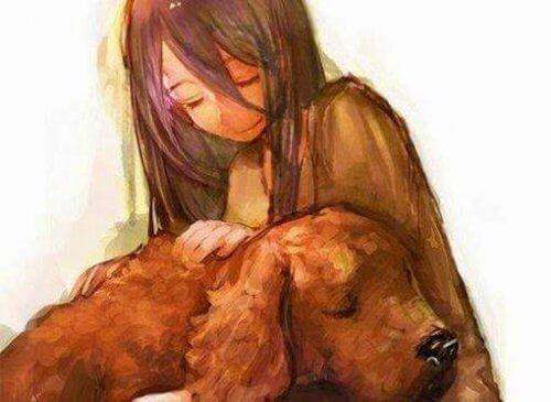 bambina che accarezza un cane