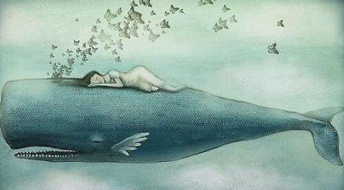 ragazza che dorme su balena da cui escono farfalle