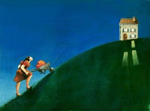 uomo che porta una pietra su una collina