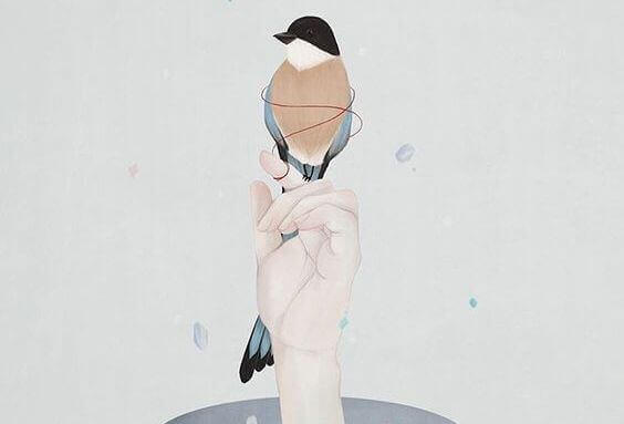 Mano con uccello
