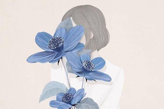 Ragazza con fiori azzurri